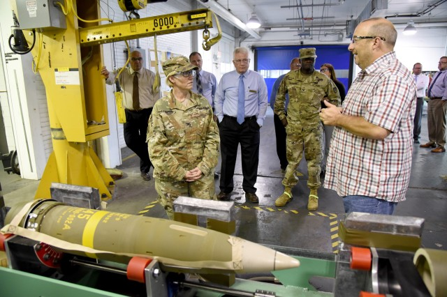 Terry Moore, non-destructive test leader supervisor at McAlester Army Ammunition Plant, Okla., talks to Col. Michelle M. T. Letcher, commander of the Joint Munitions Command, about the X-ray process that random munitions undergo as part of the quality control process during a visit to the installation, Sept. 4.
