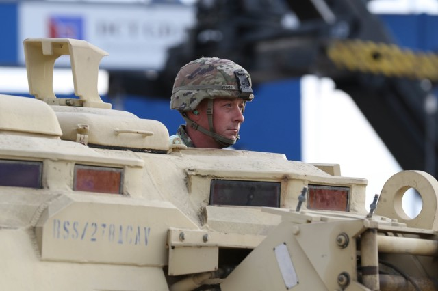 A Soldier with the 2nd Squadron, 278th Armored Calvary Regiment, drives a M88 recovery vehicle off the Liberty Pride deep water container ship at the port of Gdansk in Gdansk, Poland August 29, 2018.The decision to deploy the U.S. enhanced Forward Presence battle group in Poland was made exclusively because doing so will most effectively reinforce NATO's conventional deterrence.Poland is one of the four framework nations for NATO's eFP, Operation Atlantic Resolve, a nine-month training mission for reserve, National Guard and active duty units with NATO partners in the commitment to peace, security and stability in Europe. (U.S. Army photo by: Staff Sgt. Michael Eaddy)