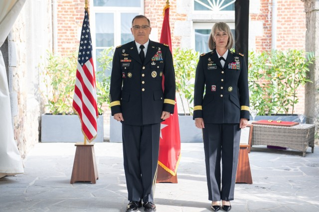 General Curtis M. Scaparrotti, Supreme Allied Commander Europe, stands next to Brig. Gen. Amy Hannah, chief of SHAPE Public Affairs, during Hannah's promotion ceremony Sept. 5, 2018. Brig. Gen. Hannah has served in the military for 27 years, working multiple tours alongside General Scaparrotti. (NATO photo by Tech. Sgt. Cody H. Ramirez, USAF)