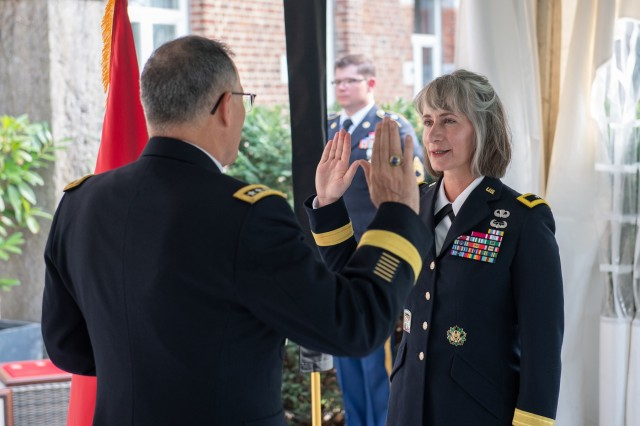 General Curtis M. Scaparrotti, Supreme Allied Commander Europe, offers an oath of commitment to Brig. Gen. Amy Hannah, chief of SHAPE Public Affairs, for her new role as a general officer during Hannah's promotion ceremony Sept. 5, 2018. Brig. Gen. Hannah has served in the military for 27 years, working multiple tours alongside General Scaparrotti. (NATO photo by Tech. Sgt. Cody H. Ramirez, USAF)