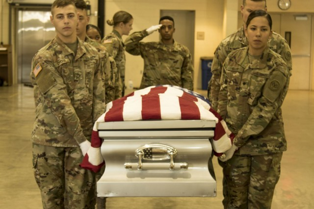 New York Army National Guard Soldiers simulate a casket move to a markup with Military honors precision as course trainers guide them, this is part of the casket carry sequence during the 40-hour Level One Military Funeral Honors Course at Camp Smith Training Site, Cortlandt Manor, N.Y., Aug. 30, 2018. This physically demanding course is designed to train and test Soldiers' abilities at the nine unique positions of the modified military funeral honors expected for service members who have not be dishonorable discharged.