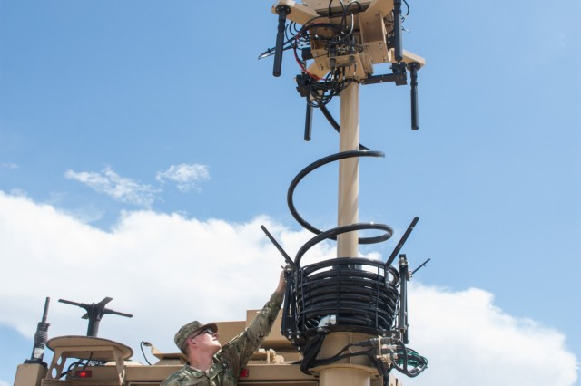 YUMA, Arizona---Staff Sgt. Andrew Malott, 3rd Armored Brigade Combat Team, 1st Cavalry Division, Electronic Warfare Tactical Vehicle Operator, raises the antenna on the EWTV during training here August 20.  Greywolf is the first BCT to receive the new vehicle developed to provide Army Electronic Warfare Teams with the ability to sense and jam enemy communications and networks from an operationally relevant range at the brigade combat team level.