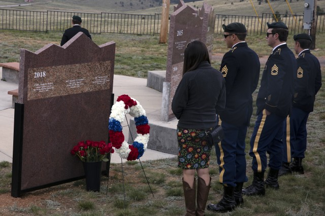 Soldier's and their family member's from 10th Special Forces Group (Airborne) pay respects to their fallen team members at Cripple Creek's War on Terrorism memorial, August 19, 2018. Cripple Creek added the names of Sgt. 1st Class. Stephen B. Cribben and Sgt. 1st Class. Mihail Golin who were both killed in Afghanistan in 2017 while serving with the 10th SFG. (U.S. Army photo by Sgt. Dustin Miller)