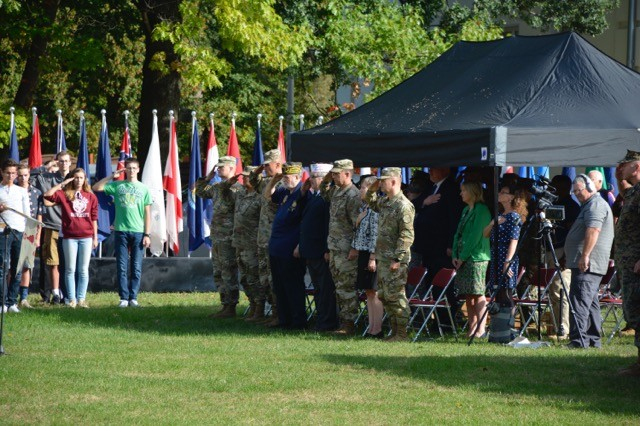 The USAG Stuttgart command team, VIPs, guests and the Stuttgart High School JROTC salute during the national anthems of Germany and the United States during the garrison's 9-11 remembrance ceremony.