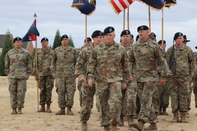 "Col. Jay Miseli, 2nd Stryker Brigade Combat Team, 2nd Infantry Division commander, leads Command Sgt. Maj. Mullinax and Command Sgt. Maj. Graves off the parade field after passing of the Lancer Brigade's Colors during a change of responsibility ceremony at Lancer Field, Joint Base Lewis-McChord, Aug. 23. ""CSM Graves and Anna, on behalf of the Soldiers and families of the Lancer Brigade, thank you for your leadership and genuine care for this formation,"" said Miseli."