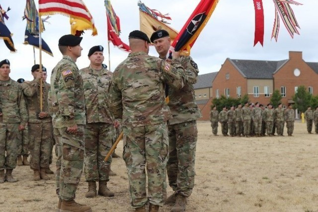 "Command Sgt. Maj. Ronald J. Graves passes the Lancer Brigade's Colors to Col. Jay Miseli, 2nd Stryker Brigade Combat Team, 2nd Infantry Division commander, symbolizing the transfer of his position of responsibility and authority during a Change of Responsibility ceremony at Lancer Field, Joint Base Lewis-McChord, Aug. 23. ""These colors represent the history of the Soldiers who have fought before us to preserve our freedom,"" said Graves. ""While 2-2 SBCT is relatively young in comparison to our subordinate units, one thing I have learned during my tenure is we are a team."""