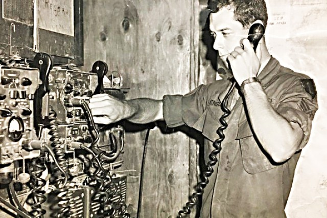 Ted Englemann operates a radio at the Tactical Operations Center in Vietnam.
