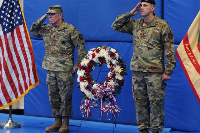 U.S. Army Garrison Fort A.P. Hill commander Lt. Col. Michael E. Gates (right) and Command Sgt. Maj. Joseph Reilly placed a wreath to honor those lost during the attacks on America on Sept. 11, 2001 during the 9/11 Commemoration at Fort A.P. Hill.