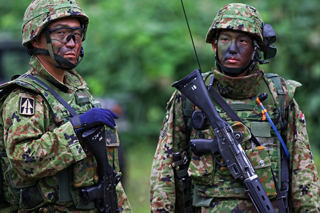 A member of the Japan Ground Self Defense Force is seen donning the 76th Infantry Brigade Combat Team patch before bilateral live-fire training during Orient Shield 2018.