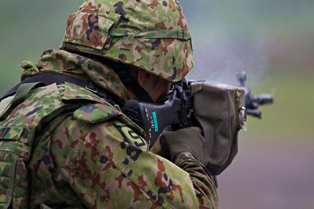 A member of the Japan Ground Defense Force takes aim for training exercise Orient Shield 2018.