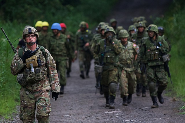 A Soldier of the 76th Infantry Brigade Combat Team escorts Japan Ground Self Defense Force personnel back to the starting point of a live-fire training exercise during Orient Shield 2018.