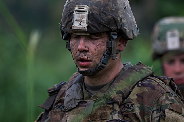A Soldier of the 76th Infantry Brigade Combat Team takes a moment after cease-fire of a live-fire training exercise during Orient Shield 2018.