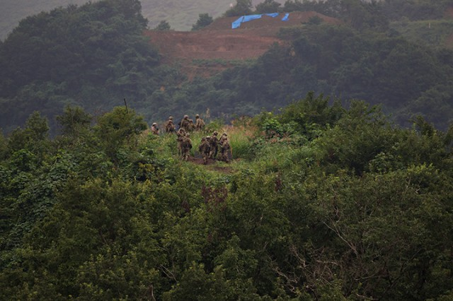 Soldiers of the 76th Infantry Brigade Combat Team conduct live-fire training exercises from an elevated position for Orient Shield 2018.
