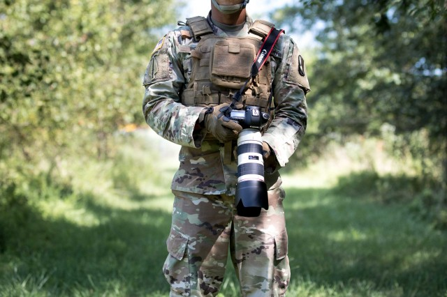 Staff Sgt. Rashard Usry, assigned to 55th Signal Company (Combat Camera), uses his new Tactical Digital Media kit at Fort Meade, Md., on Aug. 24, 2018.