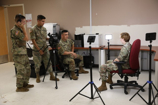 Pfc. Joshua Hugley, Spc. Joseph Friend, Pfc. Aaron Mitchell and Pfc. Katelyn Strange of 55th Signal Company (Combat Camera) use their new Tactical Digital Media kit at Fort Meade, Md., on Aug. 9, 2018.
