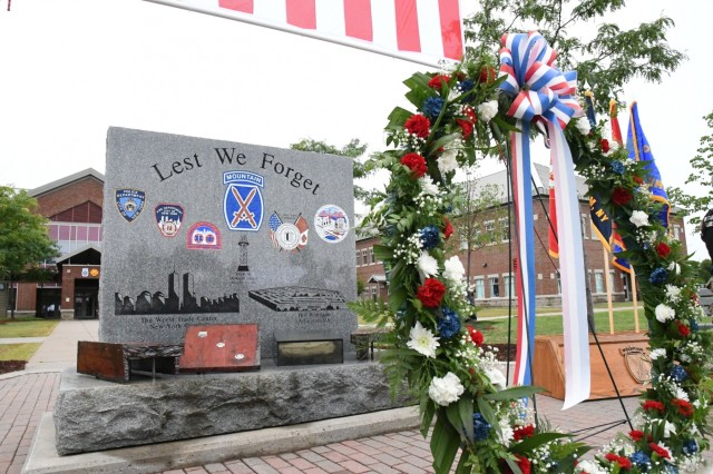 Fort Drum community members observed the 17th anniversary of the 9/11 attacks during two events Sept. 11 on post. A 9/11 wreath-laying ceremony was conducted at the 9/11 monument outside Clark Hall with the post's first responders and roughly 200 community members in attendance. Earlier, Family and Morale, Welfare and Recreation staff hosted a 9/11 Remembrance Run outside Magrath Sports Complex for Soldiers, family members and Department of Defense civilians. (Photo by Mike Strasser, Fort Drum Garrison Public Affairs)