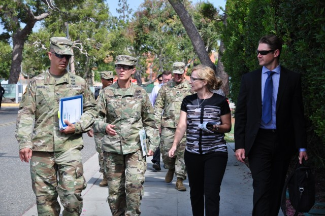"""Let's ensure we clearly communicate with the veteran community that construction work can sometimes be disruptive and what our team is doing to minimize that disruption,"" said USACE South Pacific Division Commander Col. Kim Colloton during a visit to the VA Long Beach Healthcare System Medical Center. ""But the end result will be better facilities so the VA can continue to deliver the best care to those who have given so much in service to our Nation."" The $300 million VA Long Beach project consists of five phases. The first phase includes a behavioral/mental health facility and a 40 bed inpatient facility.Photo: USACE Los Angeles District Commander Col. Aaron Barta, South Pacific Division Commander Col. Kim Colloton, Project Manager Monica Eichler, and Deputy District Engineer David Van Dorpe."