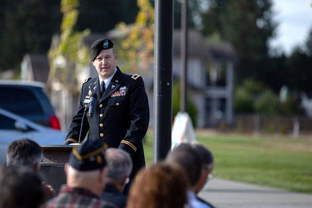 Madigan Commander Col. Thomas Bundt addresses an audience on the opening of the Madigan school-based health clinics at Bethel High School and Bethel Middle School during the National Day of Service and Remembrance ceremony Sept. 11 at the Bethel Learning Center in Spanaway, Wash.