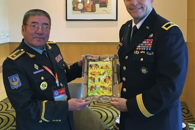 Pacific Ocean Division (POD) Commanding General, Brig. Gen. Thomas Tickner (right) receives an official gift during an exchange with Brig. Gen. Bujiinov Amgalanbaatar (left), Commanding General, Mongolia Land Forces Command, while attending the 42nd Pacific Armies Management Seminar (PAMS) Aug. 20-23, in Hanoi, Vietnam, discussing key topics, to include land forces response to HA/DR (Humanitarian Assistance/Disaster Relief), multilateral cooperation and enhancing roles in the Indo-Pacific regional HADR search and rescue. As the U.S. Army Corps of Engineers expert in the Indo-Pacific region, a component of POD's mission is to integrate capabilities and enablers in support of disaster preparedness and response.