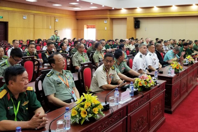 Pacific Ocean Division (POD) Commanding General, Brig. Gen. Thomas Tickner (first row, 5th from left) and Army delegations from 26 Indo-Pacific countries receive a briefing from senior officials at Vietnam's National Committee for Disaster, Incident Response, and Search and Rescue (VINASARCOM) during the 42nd Pacific Armies Management Seminar (PAMS) Aug. 20-23, in Hanoi, Vietnam. VINASARCOM is responsible for guiding and directing Vietnam's ministries and branches to elaborate and implement the disaster management strategy, long-term and annual plans for disaster management and SAR. Tickner served as one of five senior U.S. delegates representing U.S. Army Pacific (USARPAC) at the multinational military seminar. As the U.S. Army Corps of Engineers expert in the Indo-Pacific region, a component of POD's mission is to integrate capabilities in support of disaster preparedness and response.