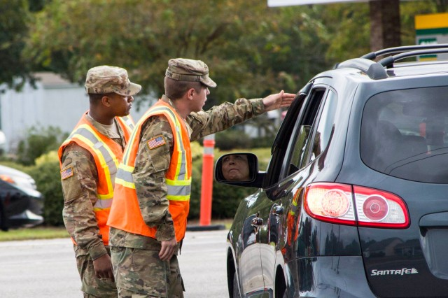 South Carolina National Guard Soldiers from the 178th Field Artillery work with South Carolina Highway Patrol officers at a traffic control point in Conway, S.C. during the lane reversal of Highway 501 in support of the Myrtle Beach area evacuation to safeguard the citizens of the state in advance of Hurricane Florence, Sept. 11, 2018.