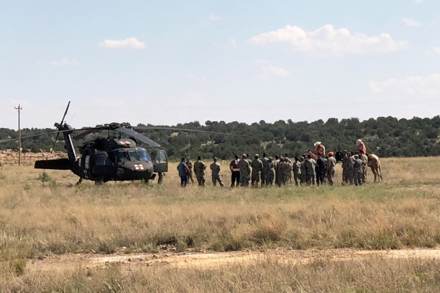 SANTA ROSA LAKE, N.M. -- Participants gather during Operation Pave Hawk, Aug. 4, 2018.