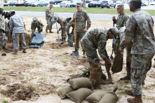 3rd Expeditionary Sustainment Command Soldiers fill sandbags in preparation for Hurricane Florence at Fort Bragg, North Carolina, Sept. 12, 2018.