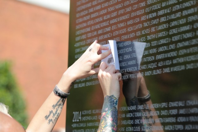 FORT BENNING, Ga. (Sept. 13, 2018) - Attendees of the Global War on Terrorism Memorial rededication ceremony take rubbings of the new names etched into the granite panels. The National Infantry Museum at Columbus, Georgia, held the inaugural rededication of its Global War on Terrorism Memorial Sept. 8. This rededication meets the promise made in 2017 that for each year the Global War on Terror continues, new names will be added to the memorial so that no Soldier's sacrifice will ever be forgotten. Each year the ceremony is scheduled to take place the first Saturday after Labor Day. (U.S. Army photo by Markeith Horace, Maneuver Center of Excellence, Fort Benning Public Affairs)