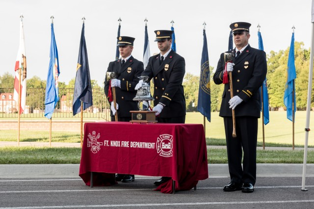 Firefighters from Fort Knox ring the bell in honor of those who lost their lives in 9/11 and in the wars that resulted from the terrorist attacks.