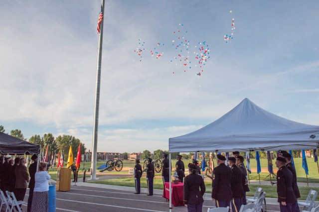 Community members watch as balloons rise from the ceremony in a silent reminder of the 2,977 spirits that left the Earth Sept. 11, 2001.