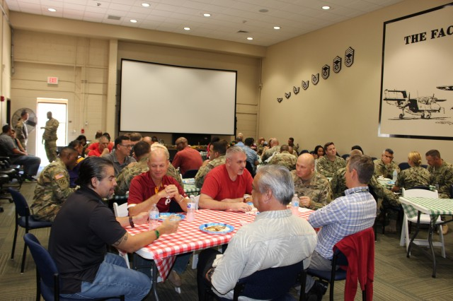 Commanders forum participants get together with brigade headquarters staff for a potluck lunch at the headquarters on Sept. 7.