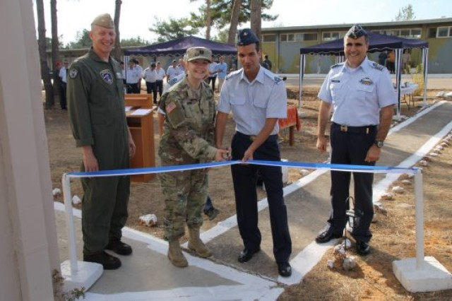 2nd Lt. Alexandros Starras, a Greek Military Veterinarian with the 115th Combat Wing, and U.S. Army Capt. Kiva Auten, the Sigonella Veterinary Services branch chief, cut the ribbon for a new Greek Military Veterinary Support Station in Crete, Greece.