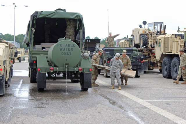 3rd Expeditionary Sustainment Command Soldiers load equipment in preparation for Hurricane Florence at Fort Bragg, N.C., Sept. 12, 2018.