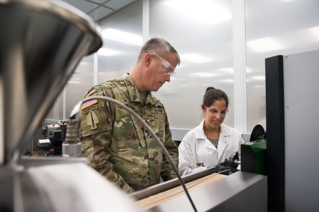 Sgt. Maj. David Snipes (left) learns about additive manufacturing advances from recycled plastics with the U.S. Army Research Laboratory's Dr. Nikki Zander.