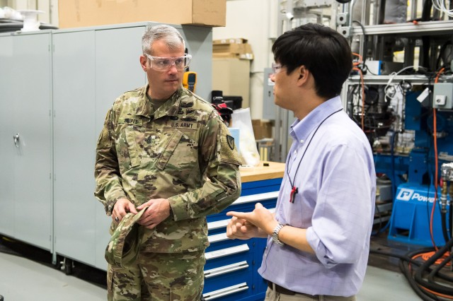 Sgt. Maj. David Snipes (left) speaks with Dr. Kenneth Kim at the Vehicle Technology Laboratory at Aberdeen Proving Ground, Maryland, Sept. 12, 2018.