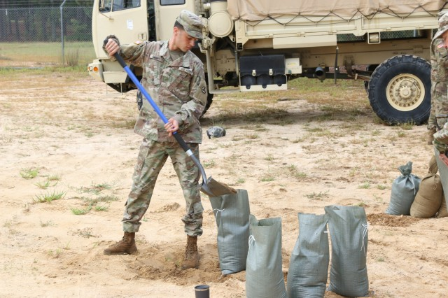 A 3rd Expeditionary Sustainment Command Soldier fills sandbags in preparation for Hurricane Florence at Fort Bragg, N.C., Sept. 12, 2018.