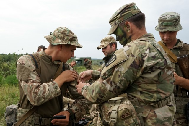 California National Guard Soldiers trade patches with Ukrainian service members at the International Peacekeeping and Security Centre in Yavoriv, Ukraine, Sept 7, 2018. During breaks in training, troops participated in the tradition of swapping patches. The troops also performed tactical training during the multinational Rapid Trident exercise.