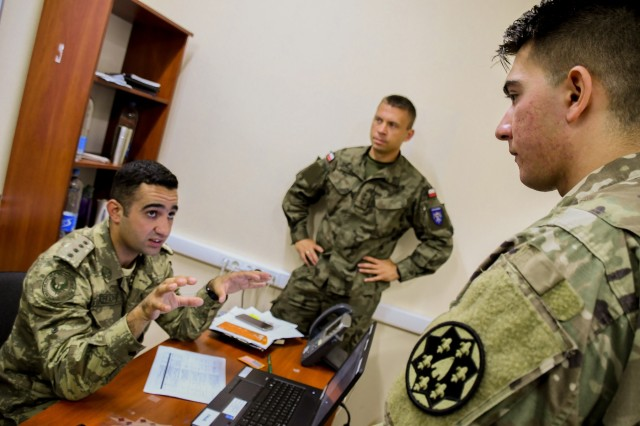 California National Guard 115th Regional Support Group work with international members in the computer-assisted command post exercise for Rapid Trident Sept. 5, 2018. The main training objective for the CPX is for Ukrainians to practice the decision-making process using NATO standards and procedures.