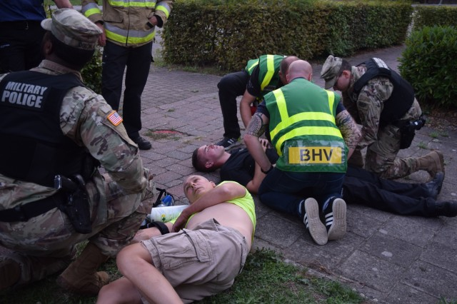 First-aid responders and military policemen tend to two more victims during the Force Protection Exercise Sept. 10, 2018, in Schinnen, The Netherlands.