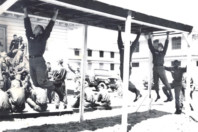 ROTC cadets negotiate obstacles during the course at Fort Knox in 1965.