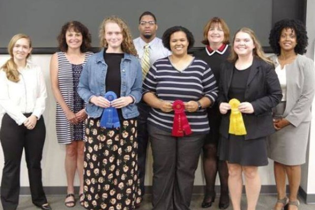 Winners of the Science and Engineering Apprenticeship Program/College Qualified Leaders Research presentation pose with their ribbons and AMRDEC employees.