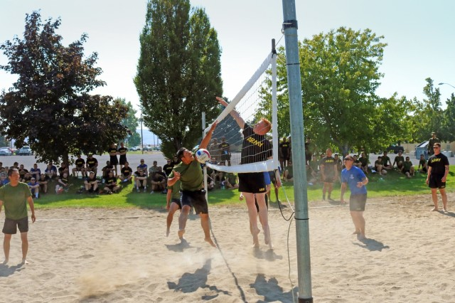 Soldiers from 1st Battalion, 17th Infantry Regiment, along with Soldiers from the 1st Infantry Regiment, Japan Ground Self Defense Force, play in a competitive game of volleyball on Sports Day during Rising Thunder 18, at the Yakima Training Center, Washington, Sept. 5. Sports day was created to allow the Japanese and American Soldiers the opportunity to strengthen friendships and build even more cohesiveness between the two forces. (U.S. Army photo by Staff Sgt. Frances Ariele Tejada)