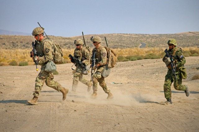 Soldiers from 1st Battalion, 17th Infantry Regiment, 2nd Stryker Brigade Combat Team, 2nd Infantry Division and a Soldier from the 1st Infantry Regiment, Japan Ground Self-Defense Force, bound forward to their objective during an urban live fire range for Exercise Rising Thunder 18, at Yakima Training Center, Washington, Sept. 7. This 15-day exercise helps enhance Soldiers' tactical skills in order to improve readiness within our units and with the Japan Ground Self-Defense Force. (U.S. Army photo by Staff Sgt. Frances Ariele Tejada)
