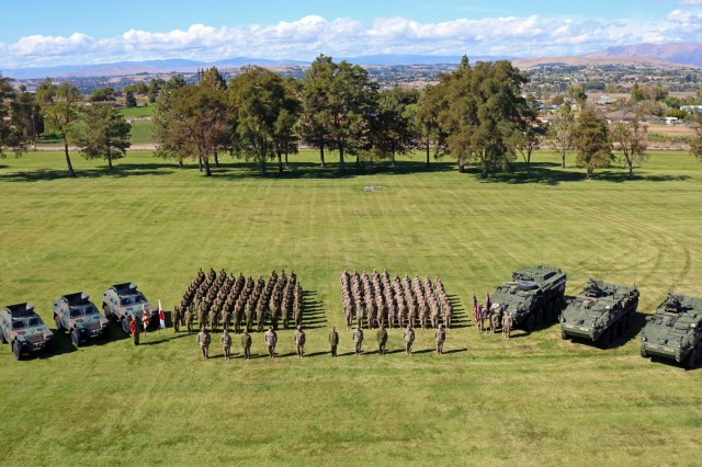 "Soldiers from Chosin Company, 1st Battalion, 17th Infantry Regiment, 2nd Stryker Brigade Combat Team, 2nd Infantry Division, along with Soldiers from the 1st Infantry Regiment, Japan Ground Self Defense Force end their closing ceremony with a commemorative group photo for their 15-day exercise, ""Rising Thunder 18"" at the Yakima Training Center, Washington, Sept. 14, 2018. This exercise gave both forces an opportunity to help strengthen allied partnerships, develop readiness and train together as a unified team. (U.S. Army photo by Staff Sgt. Frances Ariele Tejada.)"