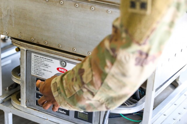 A Soldier with Company J, 1st Battalion, 41st Infantry Regiment, 2nd Infantry Brigade Combat Team, 4th Infantry Division, turns on a burner, Sept. 6, 2018, in a mobile kitchen trailer in Tarin Kowt, Afghanistan. Soldiers from Company J provide all personnel on the base with two hot meals a day. (U.S. Army photos by Staff Sgt. Neysa Canfield)