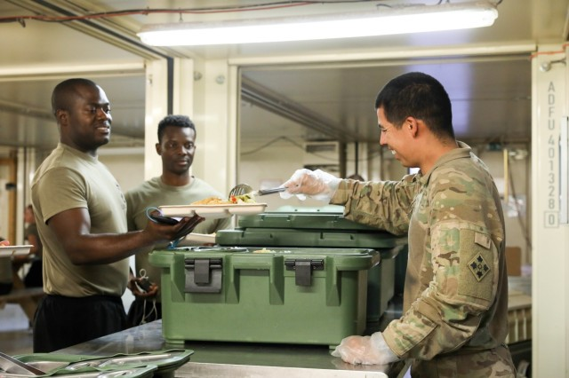 A Soldier assigned to Company B, 1st Battalion, 12th Infantry Regiment, 2nd Infantry Brigade Combat Team, 4th Infantry Division, serves vegetables during kitchen police duty, Sept. 6, 2018, in Tarin Kowt, Afghanistan. Soldiers from Company J, 1st Battalion, 41st Infantry Regiment, 2IBCT provide all personnel on the base with two hot meals a day. (U.S. Army photos by Staff Sgt. Neysa Canfield)