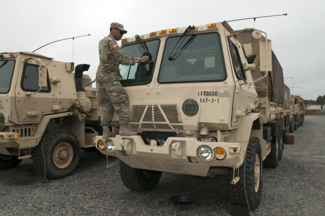 Soldiers assigned to the Virginia National Guard's 1173rd Transportation Company, 529th Combat Sustainment Support Battalion, 329th Regional Support Group assemble six Light Medium Tactical Vehicles with supplies including food, fuel, protective equipment met and wet weather gear Sept. 13, 2018, at the State Military Reservation in Virginia Beach. The LMTVs deployed to fire stations in Chesapeake, Virginia, to assist with possible hurricane response operations as Hurricane Florence makes landfall.