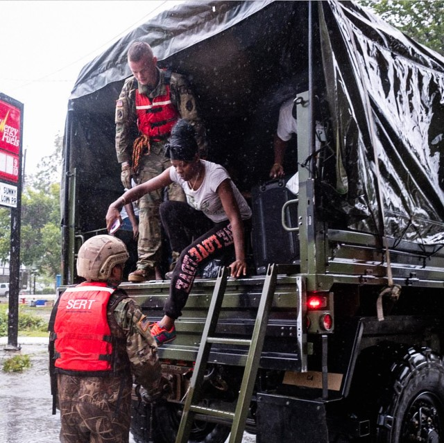North Carolina Army National Guard Soldiers help evacuate residents affected by Hurricane Florence
