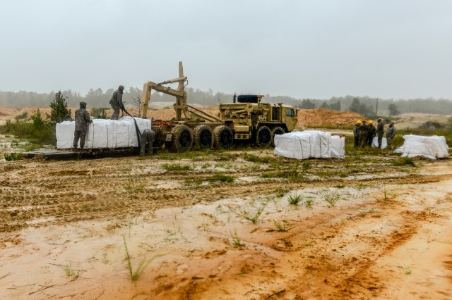 South Carolina National Guard Soldiers and S.C. Department of Transportation fill sandbags in preparation of possible flooding caused by Tropical Storm Florence, September 15, 2018. Approximately 3,200 Soldiers and Airmen have been mobilized to prepare, respond and participate in recovery efforts as forecasters project Tropical Storm Florence has the potential to cause flooding and projected to damage the state as the storm makes landfall near the Carolinas and east coast.