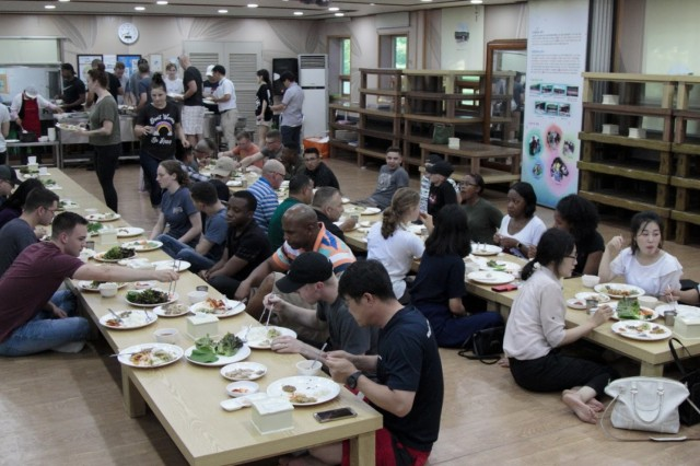 Service members eat a traditional Korean meal at Dumo Village, South Korea, during a cultural tour hosted by the Republic of Korea Ministry of National Defense, July 11, 2018. Samgandae (삼각대) is a traditional ginseng flavored chicken soup and is believed to help generate energy. (U.S. Army photo by Staff Sgt. Monik Phan)